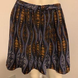 Club Monaco print button up Silk mini skirt.
